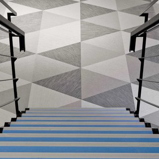 Geometric floor pattern using Bolon Studio™ Triangle tiles in the office of Skype in Stockholm, Sweden