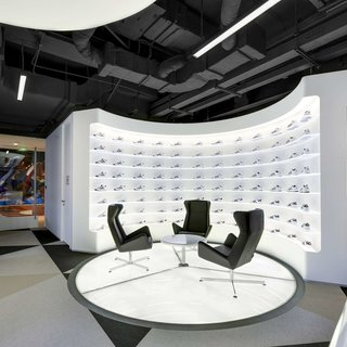 Modern triangle patterned flooring in the lounge area at the office of Adidas in Shanghai, China